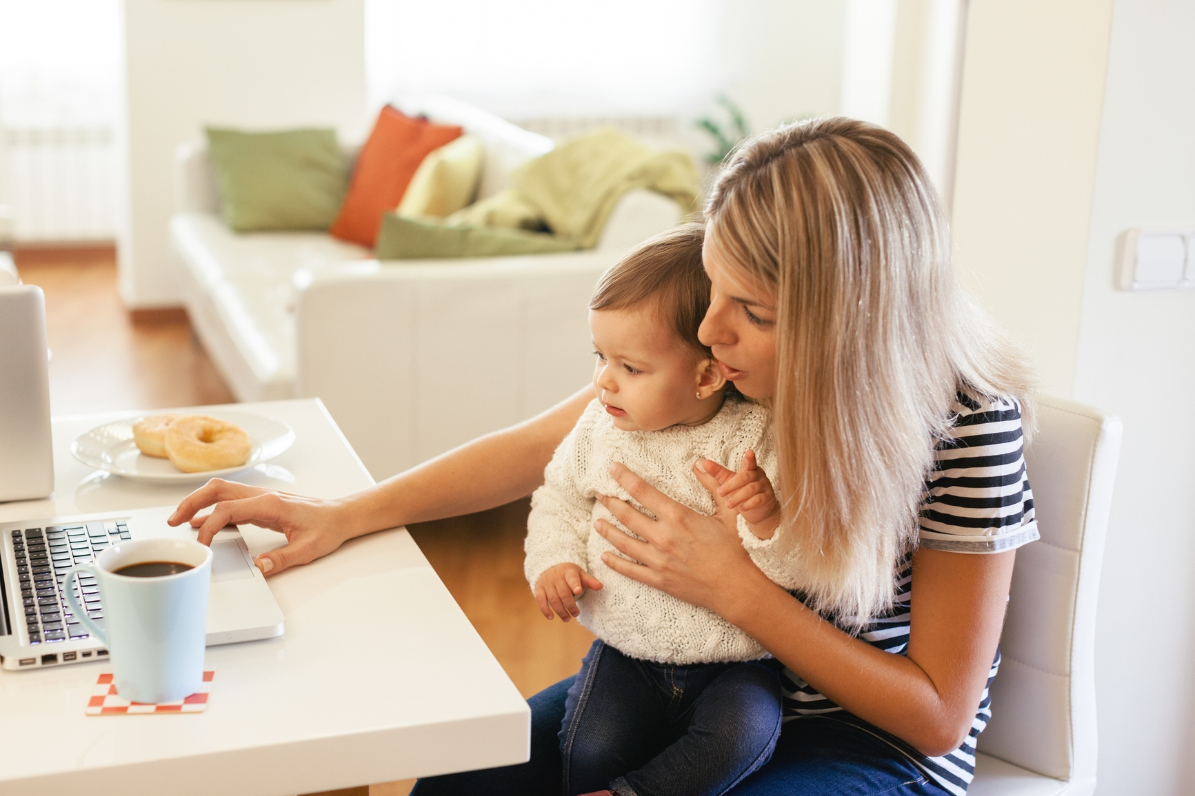 Mom at computer with child taking nutrition class