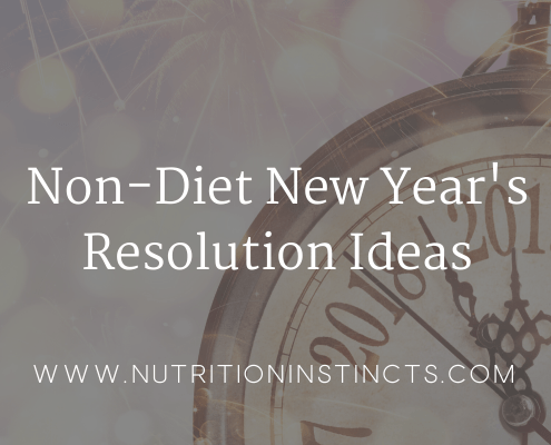 "Graphic with fireworks and clock in the background and a shaded grey overlay and words that say ""Non-Diet New Year's Resolution Ideas"" in white serif text"